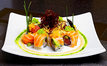 Delicious Presentation Of Colorful Sushi Platter.