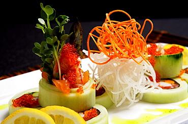 Close up view of unique sushi platter.