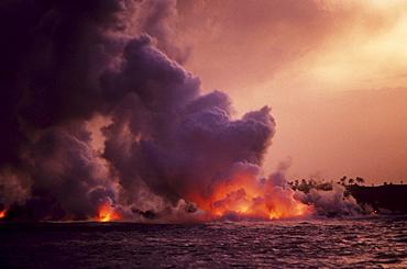 Hawaii, Big Island, Hawaii Volcanoes National Park, Molten Lava from Kilauea flowing into ocean.