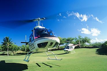 Hawaii, Big Island, Helicopter Mauna Lani Bay taking Off.
