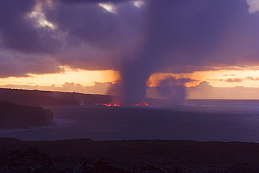 Hawaii, Big Island, Kalapana, Steam cloud formed by lava entering Pacific Ocean from Kilauea.