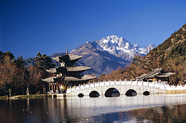 China, Lijang, Black Dragon Pool Park, Five Phoenix Pavilion, bridge and pagoda.