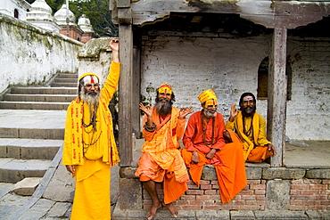 Nepal, Kathmandu,  religious men at Pashupatinath holy Hindu place on Bagmati River, painted and colorfully dressed.