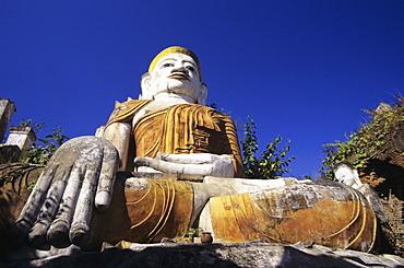 Burma (Myanmar), Inle Lake, Nanthe Village, Kyaukpygyi Paya, close-up of Buddha statue, view from below.