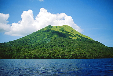 Papua New Guinea, Rabaul, The Mother Volcano, green mountainside with ocean and clouds
