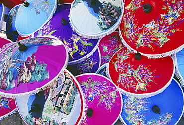 Thailand, Nakhon Pathom, detail of many colorful handpainted umbrellas overlapping