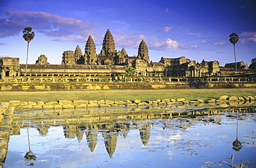 Cambodia, Siem Reap, Angkor Wat, View of temple from front, reflection in pool