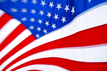 Extreme close-up of American flag star and stripes, motion