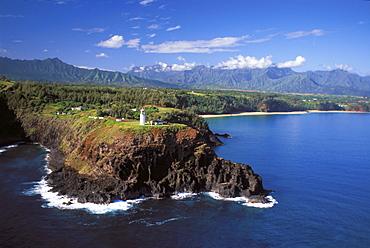 Hawaii, Kauai, Aerial of Kilauea lighthouse where ocean meets rocky point