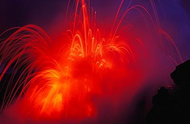 Hawaii, Big Island, Hawaii Volcanoes National Park, Lava Exploding as lava flow hits the ocean