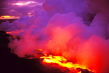 Hawaii, Big Island, Morning sky filled with pink and gray smoke, lava flow into ocean