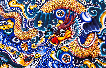 Thailand, Ayuthaya, Bang Pa-in Palace, Brightly painted Chinese style wood carvings.
