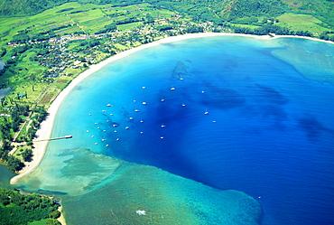 Hawaii, Kauai, aerial of  Hanalei Bay, boats in ocean
