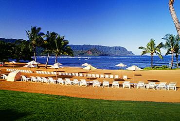 Hawaii, Kauai, Hanalei, Bali Hai, Princeville Hotel beach with lounge chairs and umbrellas