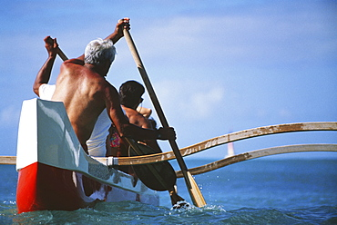 Outrigger canoe paddling, Close-up view from behind.