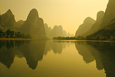 China, Guilin, Piled Silk Mountains, Li River with reflections in water A72H