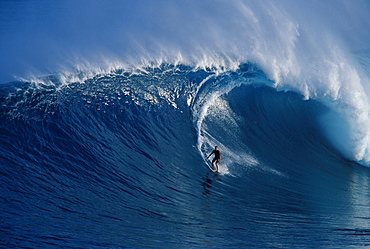 Hawaii, Maui, Buzzy Kerbox surf curling wave at Jaws aka Peahi, curling wave