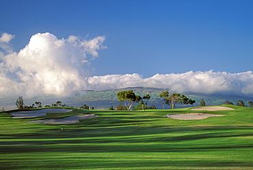 Hawaii, Big Island, Waikoloa Village Golf Course 5th hole with sand traps, shadows, blue sky
