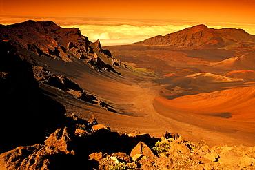 Hawaii, Maui, Golden sunlight over Haleakala Crater, National Park