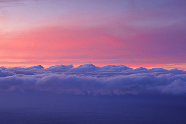 Sky at sunset with layer of puffy clouds beautiful purple and pink colors