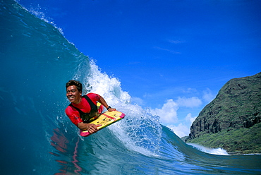 Hawaii, Body boarder Danny Kim smiling, close-up front angle, colorful