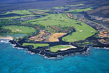 Hawaii, Big Island, Kona aerial Hualalai Resort landscape of golf course and grounds coast