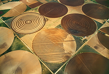 Agriculture - Aerial view of fallow center pivot irrigated circular agricultural fields / near Circle, Texas, USA.