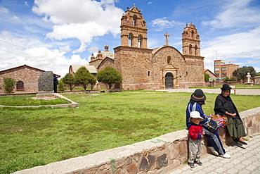Aymara People Sitting On The Plaza In Front Of The 16Th Century Church, Laja, La Paz Department, Bolivia