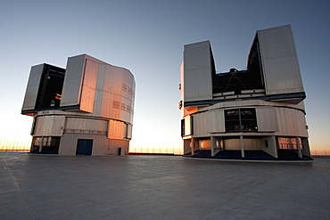 Sun Unit Telescope 1 & Moon Unit Telescope 2, Belonging To The Very Large Telescope (Vlt) Operated By The European Southern Observatory On Cerro Paranal At Sunset, Antofagasta Region, Chile