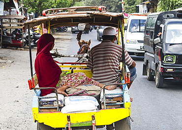 Couple on a cidomo, a horse-drawn carriage, Lombok, West Nusa Tenggara, Indonesia