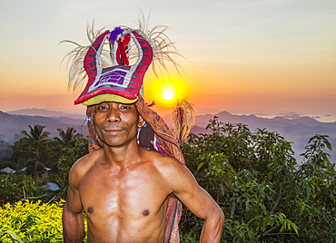 Manggarai man wearing a traditional headdress wrapped with cloth used in caci, a ritual whip fight, Melo village, Flores, East Nusa Tenggara, Indonesia