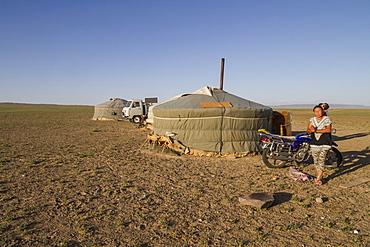 Woman by a Mongolian ger (yurt),Gobi Gurvansaikhan National Park, Ömnögovi Province, Mongolia
