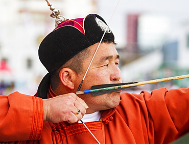 A Mongolian archer competes at the 2014 Naadam Mongolian National Festival in the archery field by the National Sports Stadium, Ulaanbaatar (Ulan Bator), Mongolia