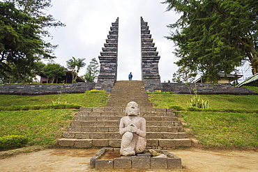 Stone statue and ceremonial gate of Candi Cetho, a Javanese-Hindu temple located on the western slope of Mount Lawu, Central Java, Indonesia