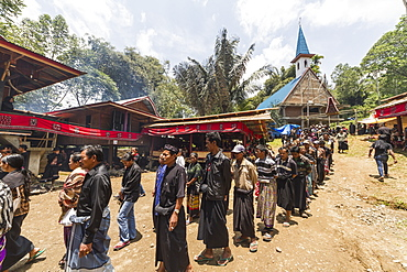 People in a formal funeral procession called Ma'passa Tedong at a rante, the ceremonial site for a Torajan funeral, in Sereale, Toraja Land, South Sulawesi, Indonesia