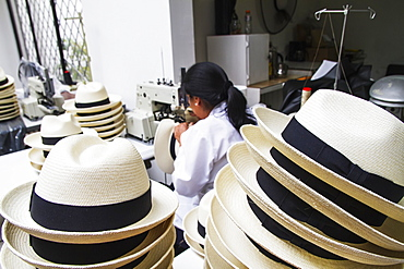 Woman sewing the black brim on to a panama hat at the Homero Ortega Panama Hat Factory, Cuenca, Azuay, Ecuador