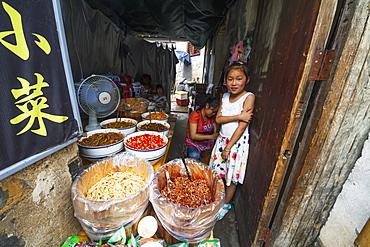 Chinese girl in a food shop, Hongcun, Anhui, China