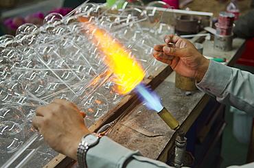 Man blowing and shaping glass, Tlalpujahua, Michoacan, Mexico