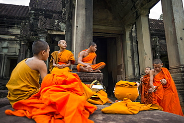 A group of young monks hang out at Angkor Wat, Siem Reap, Cambodia