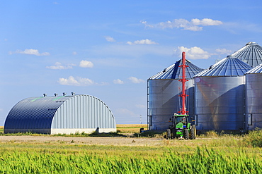 Grain silos and auger, Alberta, Canada