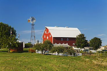 Red barn and windmill at a farm, near Edgewood, Iowa, United States of America