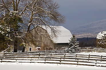 Barn roof and farmyard covered with snow in winter, Bromont, Quebec, Canada