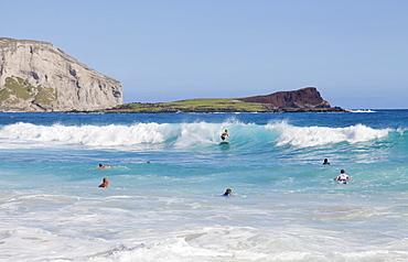 Bodyboarders catching waves at Makapu'u Beach; Waimanalo, Oahu, Hawaii, United States of America