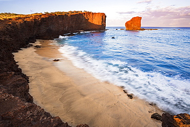 Sunset light on the clouds above Puu Pehe Rock at sunset, also known as 'Sweetheart Rock', one of Lanai's most recognizable landmarks, Lanai, Hawaii, United States of America