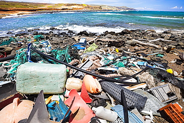 Much of the North side of the island of Molokai is inaccessible. when trade winds blow onshore regularly bringing with them piles of plastic that has been floating around the Pacific Ocean for years and years, Molokai, Hawaii, United States of America