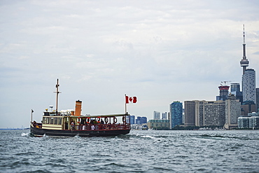 Royal Canadian Yacht Club (RCYC) launch heading to the Toronto island at dawn, Toronto, Ontario, Canada