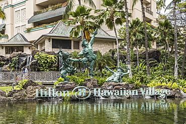Hula Kahiko dancer statues at Hilton Hawaiian Village, Waikiki, Honolulu, Oahu, Hawaii, United States of America