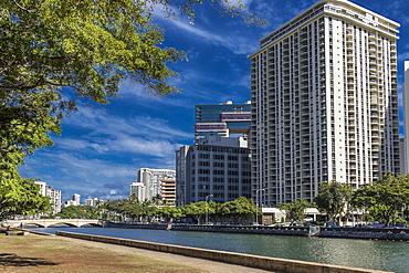 View North across Ala Wai Canal from Ala Wai Promenade towards Kalakaua Avenue bridge, Waikiki, Honolulu, Oahu, Hawaii, United States of America
