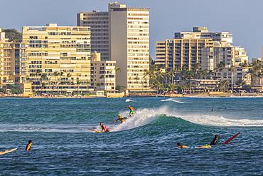 Surfing at Waikiki viewed from Magic Island, Ala Moana Beach Park, Honolulu, Oahu, Hawaii, United States of America