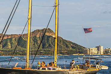 Sailing towards the Ala Wai boat harbor past Waikiki and Diamond Head, Honolulu, Oahu, Hawaii, United States of America
